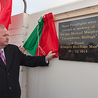 An tUachtaran Cumann Luthchleas Gael, Mr. Liam O'Neill,  unveils a plaque to honor the deceased Micheal Murphy, who erected the floodlights at the club and funded the practise pitch, during the Kilmurry Ibrickane GAA Club Centenary Closing Ceremony