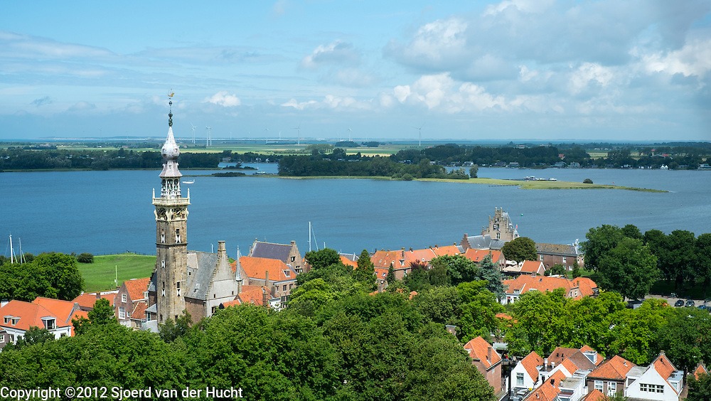 "Uitzicht vanaf de toren van de Grote Kerk in Veere, Zeeland. Kerk wordt niet meer als kerk gebruikt maar als ruimte voor culturele activiteiten. - View from the tower of the ""Grote Kerk"" church in Veere, Zeeland, Netherlands. Church is not in use as church anymore but as a space voor cultural activities"