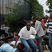 "Hundreds of university students storm the embassy grounds seeking refuge from a police advance after a 24 hour deadline to abandon the area expired earlier in the morning. The students moved to the area in early May because, they claim, the US authorities ensure their security, after their university was closed amid anti-government protests. The government closed the university at the end of April, citing ""insecurity""."