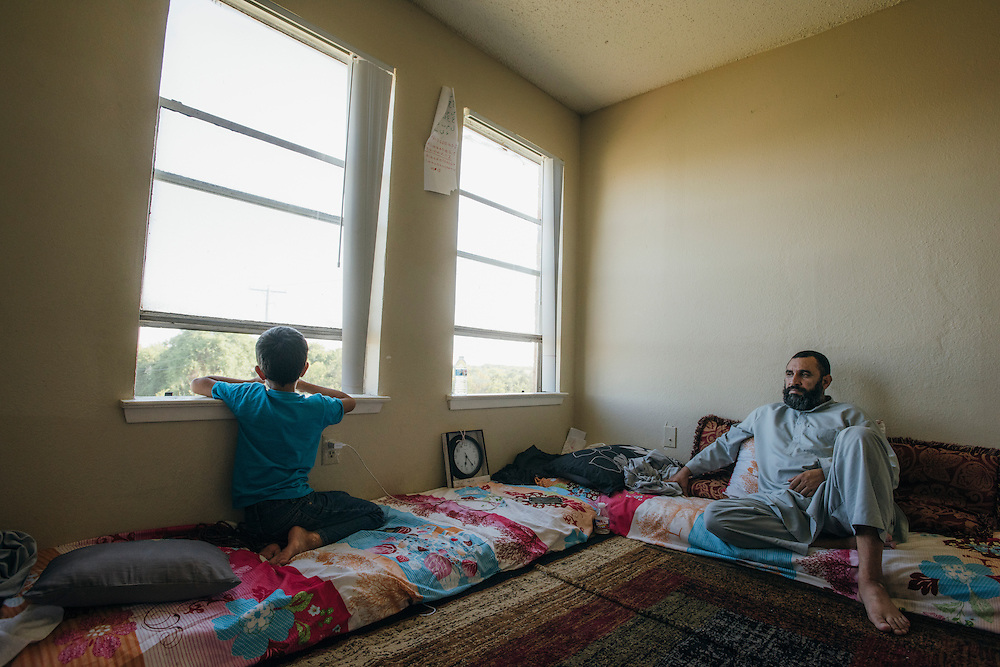 Gulab sits with one of his sons at his home in Fort Worth, Texas on May 6, 2016.