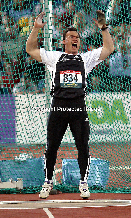 28 July 2002, City of Manchester Stadium,Sport city Commonwealth Games, Manchester, England<br />New Zealand  hammer thrower Phil Jensen  celebrates a silver medal performance in the final of the men's hammer throw competition.<br />Pic: Andrew Cornaga/Photosport