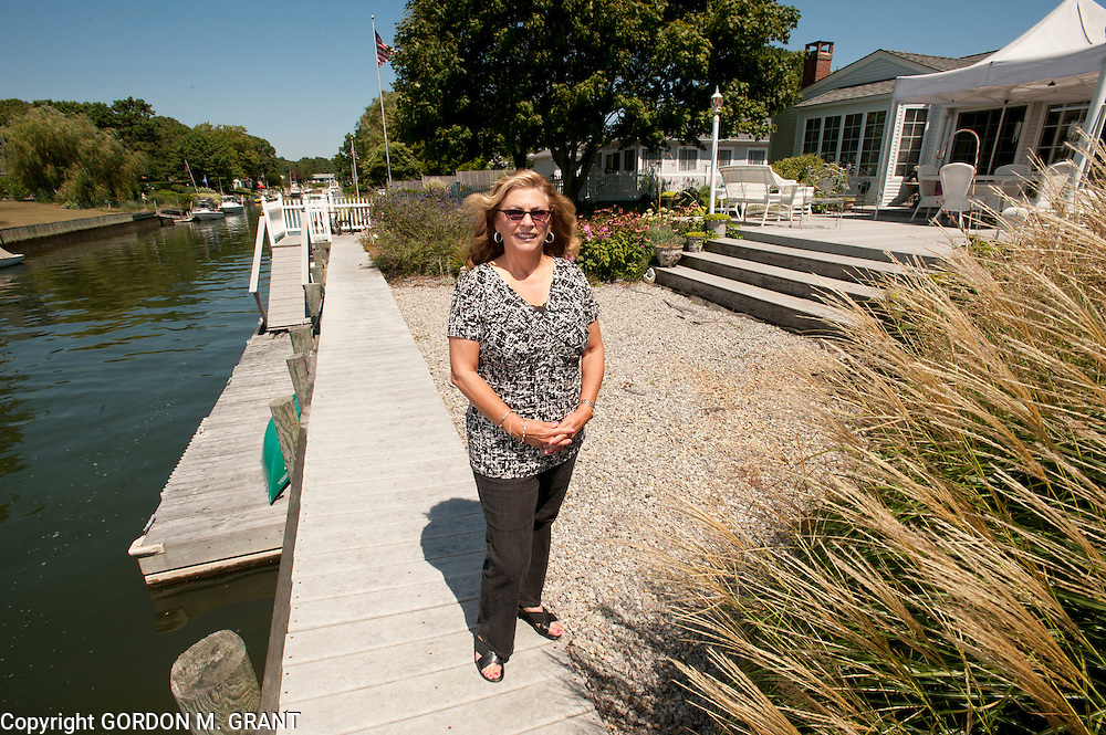 Joanne Nardo outside her home, that she has decided to buy flood insurance for, in East Quogue. (August 19, 2010)