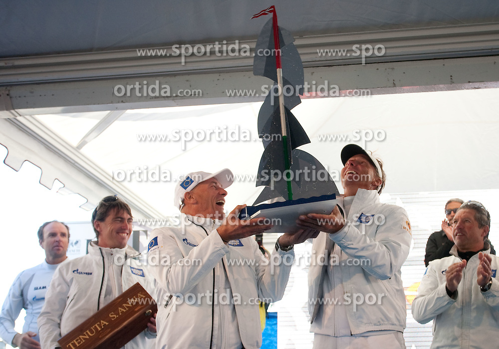 Celebration of Winning boat Esimit Europa 2 owned by Igor Simcic of Slovenia (L) and skippered by Jochen Schumann of Germany (R) during Barcolana 43 sailing regatta hosted by Societa Velica di Barcola e Grignano on October 9, 2011, in Trst / Trieste Gulf, Italy.   (Photo by Vid Ponikvar / Sportida)