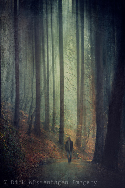 Man walking on a forest road in the twilight. Manipulated photography.
