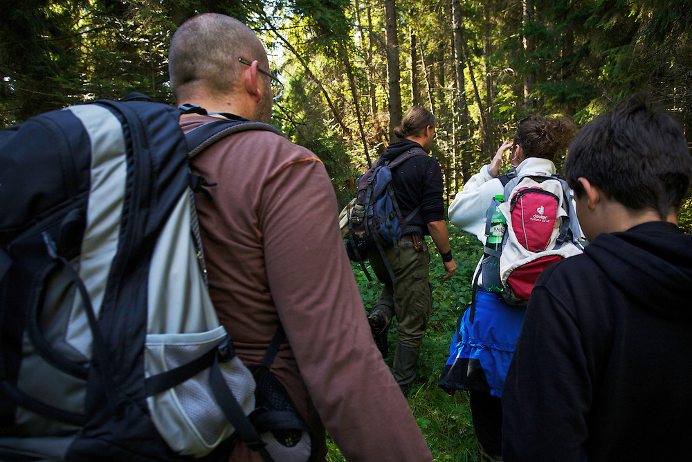 Bartosz Pirga (in the lead), wildlife biologist at Bieszczady National Park, guiding Judita Hrubesova, Krystof & Miroslav Bobek on a hike through the National Park interiors. Bukowiec, Poland.