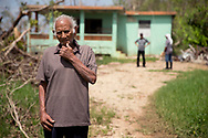 MANAT&Iacute;, PUERTO RICO - OCTOBER 10, 2017 -  94 year old Antonio Concepci&oacute;n Rios in front of his home in Manat&iacute;, Puerto Rico, where the center of Hurricane Maria caused some of the most extensive damage. Concepci&oacute;n was alive during Hurricane San Felipe (1928) and Hurricane San Ciprian (1932) where he metioned more people died, there was more devastation, but residents helped each other more. (Photo/Jos&eacute; Jim&eacute;nez) Through the Iris of Hurricane Mar&iacute;a<br />
