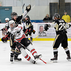 GEORGETOWN, ON  - APR 26,  2017: Ontario Junior Hockey League, Championship Series.  Georgetown Raiders vs the Trenton Golden Hawks in Game 7 of the Buckland Cup Final.  Chays Ruddy #4 and Lucas Brown #28 of the Trenton Golden Hawks tie up Josh Dickinson #28 of the Georgetown Raiders during the third period.<br /> (Photo by Shawn Muir / OJHL Images)