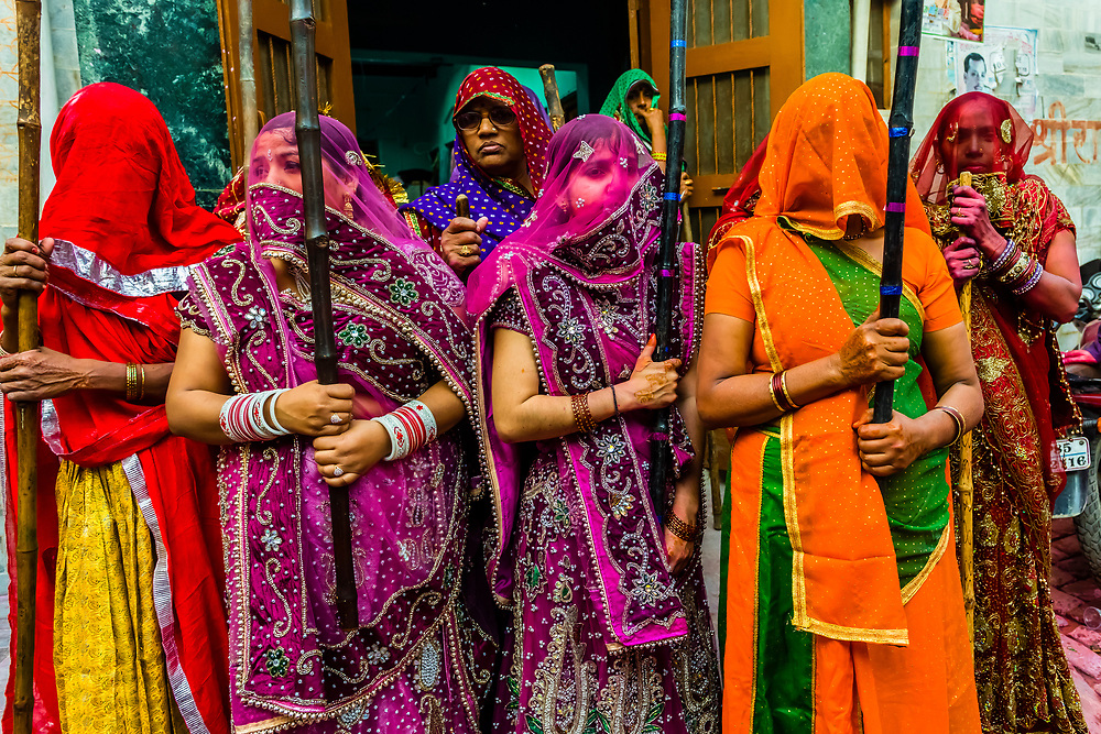Gopis (Shepherdesses) of Nandgaon Beat the Gops (Shepherds) of Barsana with Long Sticks (Laths) During Lathmar Holi Celebrations<br /> Indian villagers smear themselves with colors during the Lathmar Holi festival on March 7, 2017 in Nandgaon near Mathura, India. The women of Nandgaon, the hometown of Hindu God Krishna, attack the men from Barsana, the legendary hometown of Radha, consort of Hindu God Krishna, with wooden sticks in response to their efforts to put color on them, reciprocating acts performed the day before in Barsana between the women of that village with the men of Nandgaon as they observed the Lathmar Holi festival.