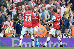 Arsenal's Kieran Gibbs Arsenal's Aaron Ramsey and Arsenal's Mathieu Flamini celebrate a goal - Photo mandatory by-line: Mitchell Gunn/JMP - Tel: Mobile: 07966 386802 22/09/2013 - SPORT - FOOTBALL - Emirates Stadium - London - Arsenal V Stoke City - Barclays Premier League