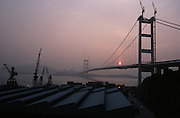 Tsing Ma Bridge to the new airport on Lantau island and container harbour at sunset.