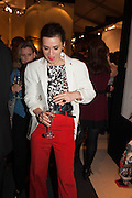Lara Bohinc shows her red trousers at the Opening of The LAPADA  Art and Antiques Fair. Berkeley Sq. London. 24 September 2013.