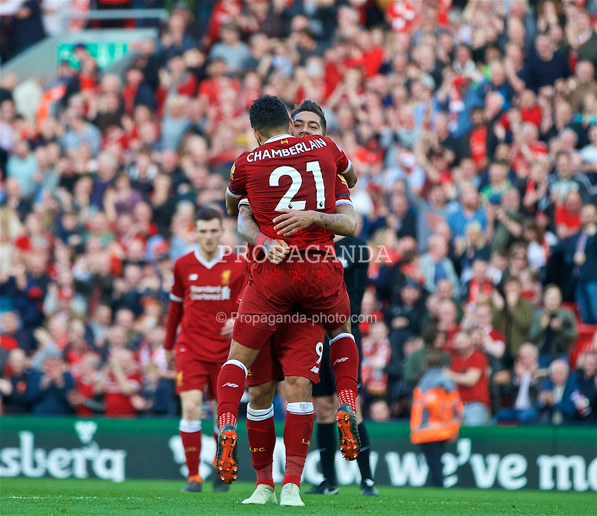 LIVERPOOL, ENGLAND - Saturday, April 14, 2018: Liverpool's Roberto Firmino celebrates scoring the third goal with team-mate Alex Oxlade-Chamberlain (#21) during the FA Premier League match between Liverpool FC and AFC Bournemouth at Anfield. (Pic by Laura Malkin/Propaganda)