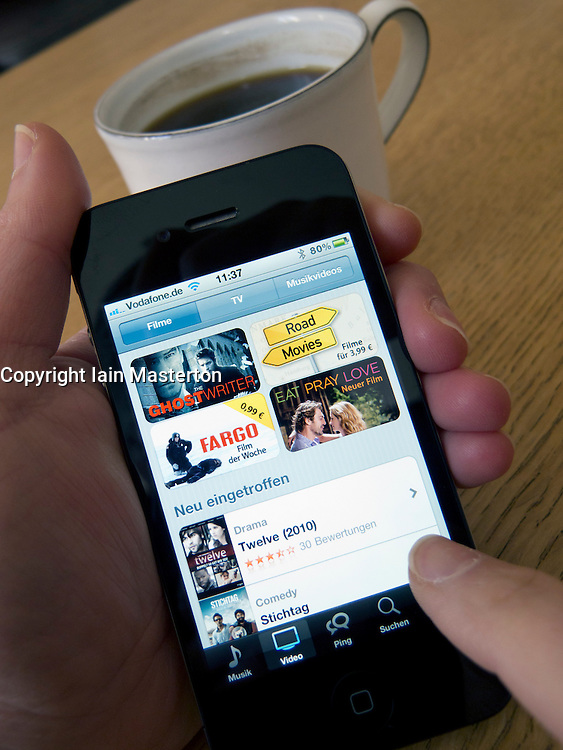 Browsing movies for purchase and download on an Apple iphone 4G smart phone