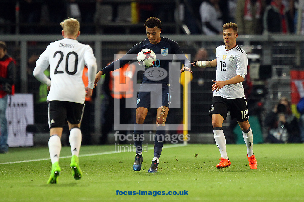 Dele Alli of England and Joshua Kimmich of Germany in action during the International Friendly match at Signal Iduna Park, Dortmund<br /> Picture by Paul Chesterton/Focus Images Ltd +44 7904 640267<br /> 22/03/2017