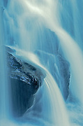 Detail of water falling over rock at  Raleigh Falls<br /> near Ignace<br /> Ontario<br /> Canada