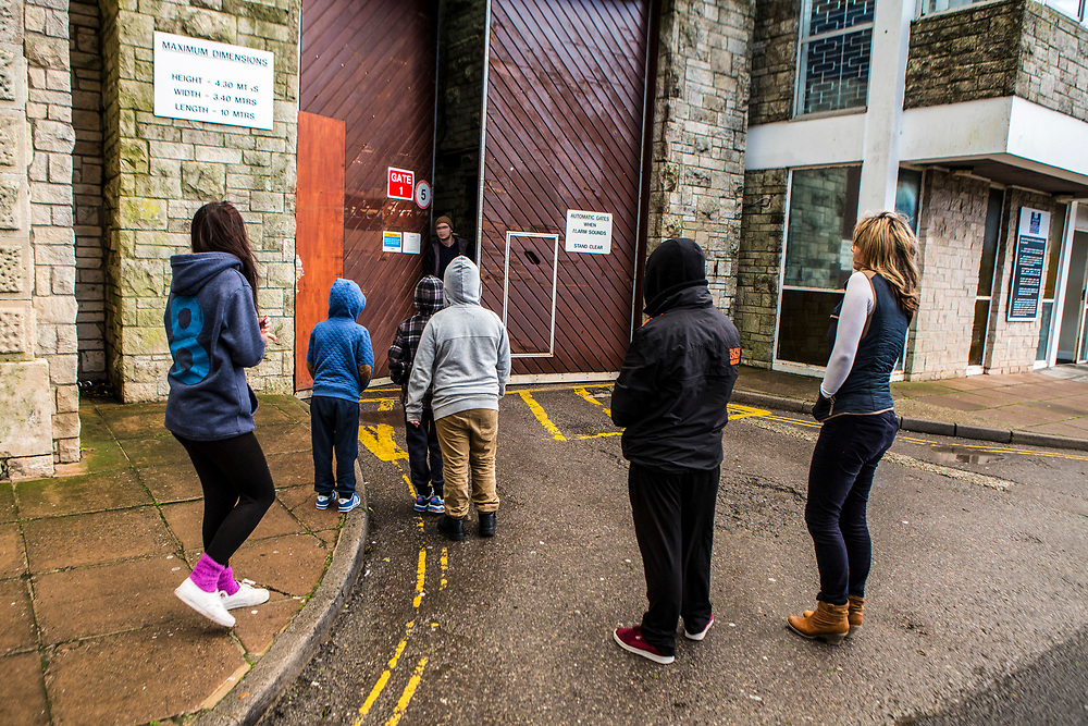 Children wait at the prison gates for the release of their dad from HMP/YOI Portland, Dorset, United Kingdom.