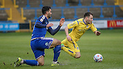 Hamza Bencherif (Halifax) takes down Gavin Rothery (Guiseley) on the edge of the Halifax box during the Conference Premier League match between FC Halifax Town and Guiseley at the Shay, Halifax, United Kingdom on 5 December 2015. Photo by Mark P Doherty.