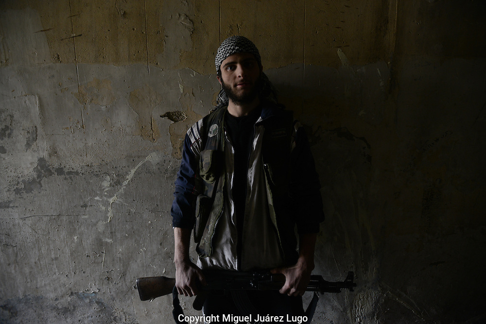 Aleppo, Syria, January 2013-    AHMED SEIO, 22, from the coastal Syrian city of Latakia, was in his third year of college studying Economy and Trade when he decided to join the Free Syrian Army rebels in Aleppo. He is stationed these days in the Old City area of Aleppo. (Photo by Miguel Juárez Lugo)