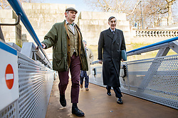 © Licensed to London News Pictures. 21/03/2018. London, UK. UKIP Former Press Officer Gawain Towler (left) and Conservative MP and prominent Brexiteer Jacob Rees-Mogg (right) meet fisherman from the 'Fisherman for Leave' campaign on Embankment Pier, London. Fishermen, many of whom who voted for Britain to leave the EU, are angry at yesterday's announcement that Britain will effectively continue to be involved in the EU's Common Fisheries Policy. Photo credit : Tom Nicholson/LNP