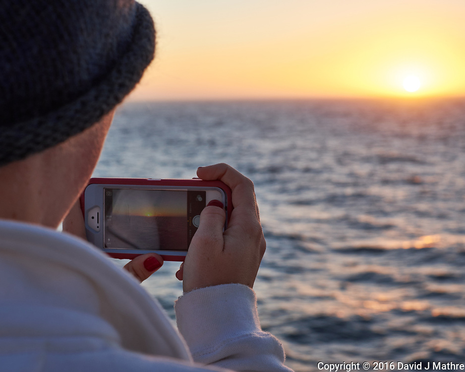 Picture in Picture of the Sun Rising over the Atlantic Ocean from the Aft Deck of the MV World Odyssey. Image taken with a Fuji X-T1 camera and 35 mm f/1.4 lens