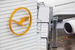 THEMENBILD, Airport Muenchen, Franz Josef Strauß (IATA: MUC, ICAO: EDDM), Der Flughafen Muenchen zählt zu den groessten Drehkreuzen Europas, rund 100 Fluggesellschaften verbinden ihn mit 230 Zielen in 70 Laendern, im Bild Lufthansa Logo am Terminal, dahinter Teil eines Flugzeuges // THEME IMAGE, FEATURE - Airport Munich, Franz Josef Strauss (IATA: MUC, ICAO: EDDM), The airport Munich is one of the largest hubs in Europe, approximately 100 airlines connect it to 230 destinations in 70 countries. picture shows: Lufthansa logo on the terminal, behind part of an aircraft, Munich, Germany on 2012/05/06. EXPA Pictures © 2012, PhotoCredit: EXPA/ Juergen Feichter