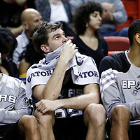 17 January 2012: San Antonio Spurs point guard Tony Parker (9), San Antonio Spurs forward Tiago Splitter (22), San Antonio Spurs center Tim Duncan (21) are seen on the bench during the Miami Heat 120-98 victory over the San Antonio Spurs at the AmericanAirlines Arena, Miami, Florida, USA.