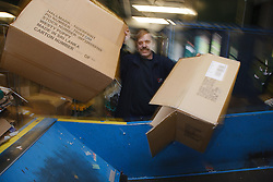 Man with a mild learning disability working as a factory operative, shown here recycling cardboard, helped into employment by the Ready 4 Work team, Nottinghamshire County Council