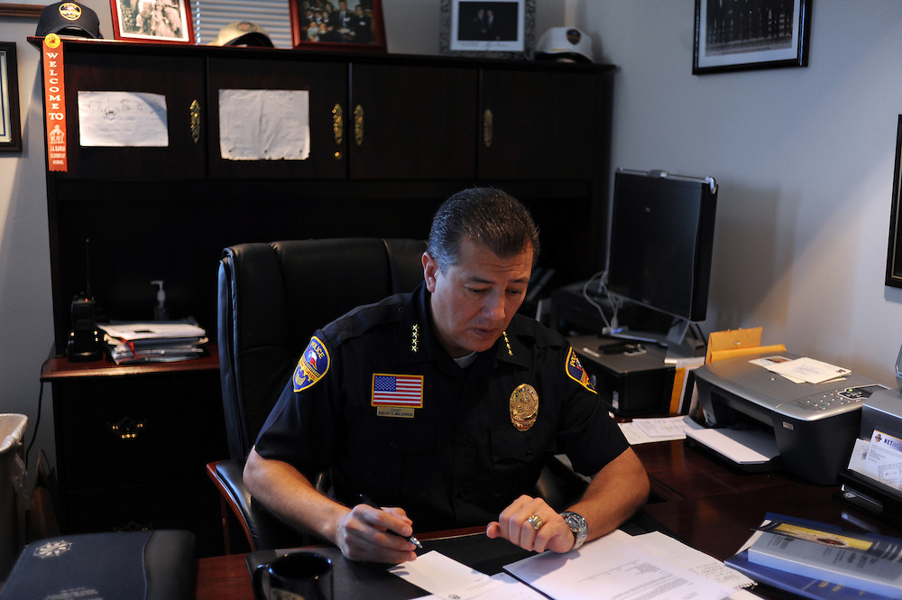 City Police Chief Carlos Maldonado works in his office on August 19, 2010 in Laredo, Texas. Maldonado's has been beefing up its force to deal with the possibility of spillover violence, but crime remains relatively low with only six murders this year. City officials say negative attitudes about the city's more dangerous sister Nuevo Laredo have kept tourists from coming and effected the over all economics of the town.