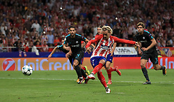 Atletico Madrid's Antoine Griezmann scores his side's first goal from the penalty spot