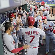 NEW YORK, NEW YORK - July 27: Matt Holliday #7 of the St. Louis Cardinals is congratulated by team mates in the dugout after driving in two runs and scoring a run himself in the third inning during the St. Louis Cardinals Vs New York Mets regular season MLB game at Citi Field on July 27, 2016 in New York City. (Photo by Tim Clayton/Corbis via Getty Images)