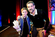 Julian Speroni poses with a young fan with a match worn signed glove he won The gloves are off. An Evening With Julian Speroni at  at Fairfields Hall, Croydon, United Kingdom on 20 January 2015. Photo by Michael Hulf.