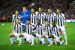 LIVERPOOL, ENGLAND - Thursday, October 4, 2012: Udinese Calcio's players line up for a team group photograph before the UEFA Europa League Group A match against Liverpool at Anfield. Back row L-R: Giampiero Pinzi, goalkeeper Zeljko Brkic, Danilo, Medhi Benatia, Maurizio Domizzi, Roberto Pereyra. Front row L-R: Giovanni Pasquale, Marco Faraoni, Pablo Armero, Antonio Di Natale, Emmanuel Badu. (Pic by David Rawcliffe/Propaganda)
