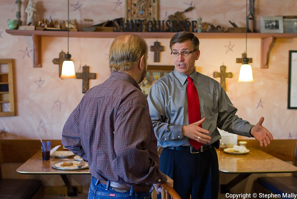 Congressman-elect Robert Schilling (IL-17) talks with a customer at his pizza shop, Saint Giuseppe's Heavenly Pizza, in Moline, Illinois on Tuesday November 9, 2010.