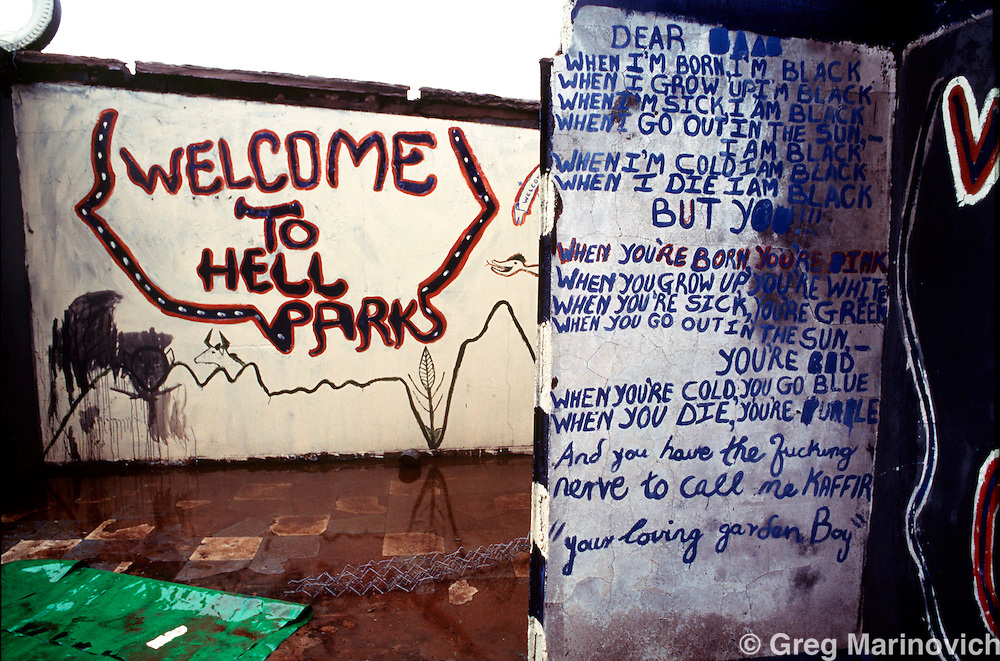 POLITICS TOKOZA SOUTH AFRICA 1992: Graffiti in a yard made into a park in an African National Congress allied residents area neighbouring a no-go zone in Tokoza township, South Africa, 1992. Part of The Dead Zone series. (Photo by Greg Marinovich / Getty Images)