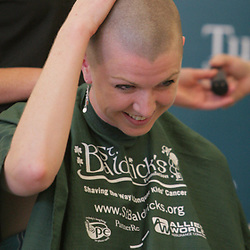 18 March 2009:  Event organizer and graduate student at Tulane School of Medicine, Jen Flament touches the top of her head after having her head shaved during the second annual St. Baldrick's children's cancer charity shave-a-thon fund raiser held at Tulane Medical Center in New Orleans, Louisiana.