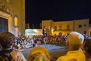 """Artist's exhibition in the street during a """"Sagra"""" in Gemini"""