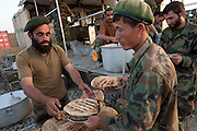 Afghan National Army soldiers receive their Iftar meal during Ramadan at Forward Operating Base Howz-e-Madad in Zhari District, Kandahar Province.
