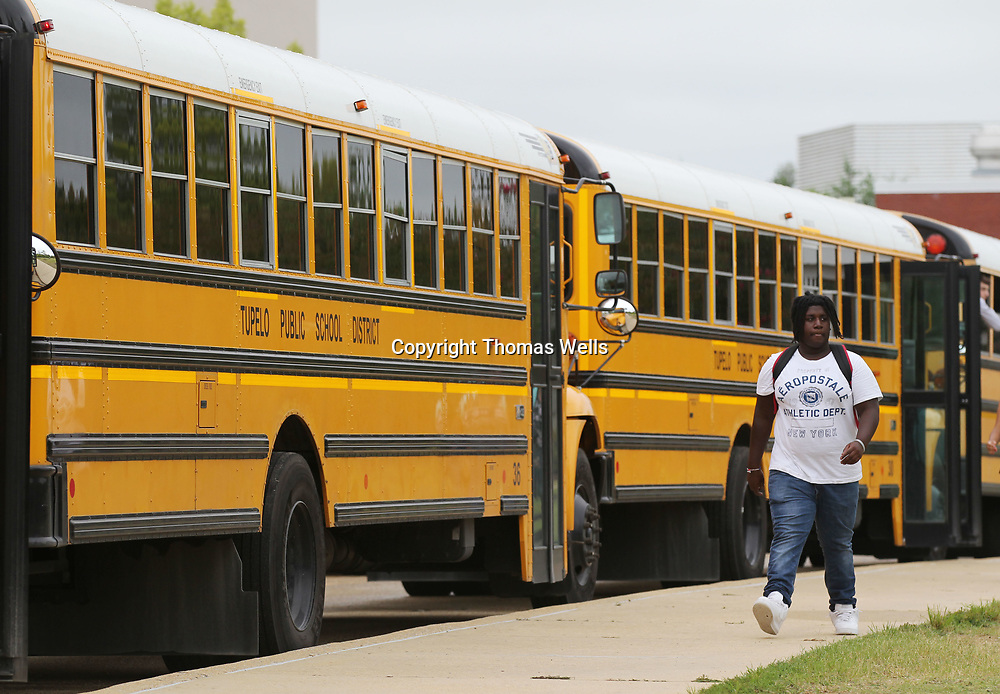 Students at Tupelo High School make their way to their buses after school om Monday.