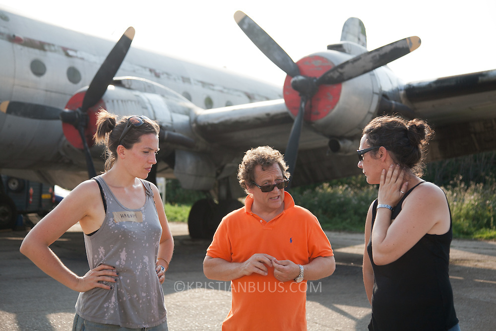 Hannah Davey and Rachel Murray from Greenpeace discuss progress with Peter Elliott. The giant polar bear Aurora is test run on North Weald Airfield near Epping. It is the first day that puppeteers get a chance to get her legs and feet moving. Aurora, a double-decker-bus-size polar bear puppet specially commissioned by Greenpeace to lead an Arctic-inspired street parade to the London HQ of oil giant Shell on 15 September. The three-tonne marionette bear will be operated from the inside by a team of 15 puppeteers, including artists from West End blockbuster War Horse, and will be hauled on ropes by 30 volunteers along a route including the Houses of Parliament and Westminster Bridge.
