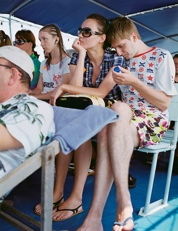 Russian tourists on the ferry to Koh Laan Island.