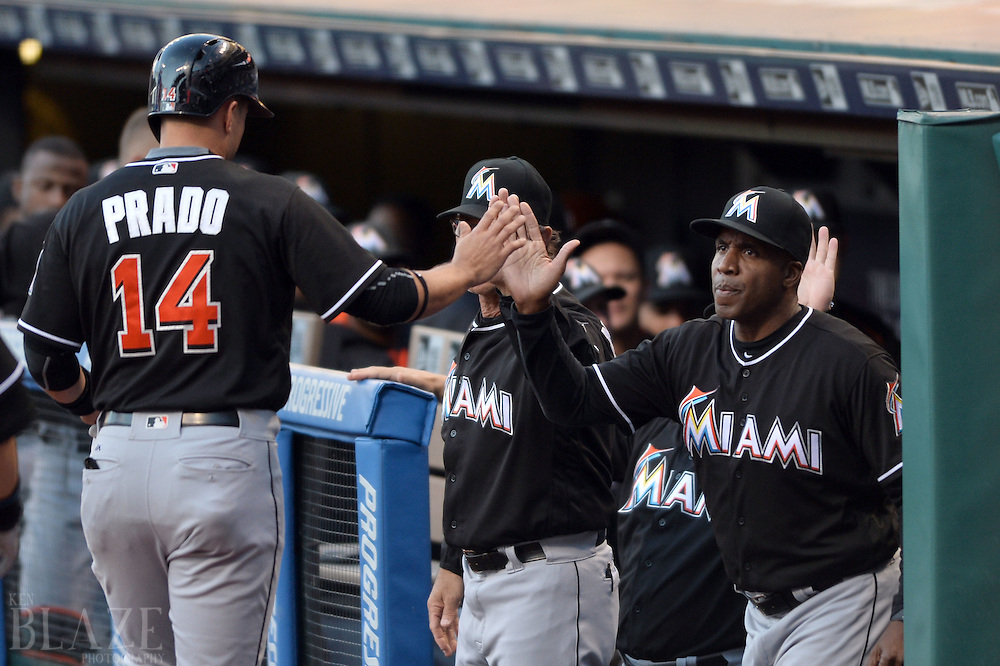 Sep 3, 2016; Cleveland, OH, USA; Miami Marlins third baseman Martin Prado (14) celebrates with Miami Marlins hitting coach Barry Bonds (25) during the first inning against the Cleveland Indians at Progressive Field. Mandatory Credit: Ken Blaze-USA TODAY Sports
