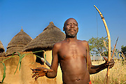 Benin, Natitingou November 30, 2006 - Man with tribal scarification on his body. Scarification is used as a form of initiation into adulthood, beauty and a sign of a village, tribe, and clan.