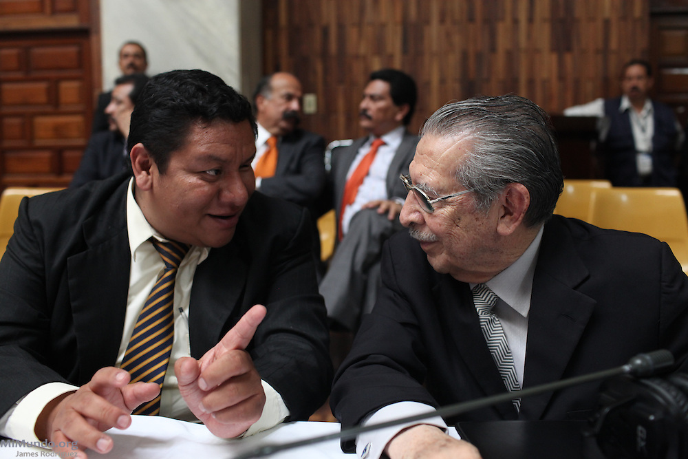 Public Defendant Otto Ramirez speaks to former de facto head of state Efrain Rios Montt during the genocide trial against Rios Montt and his former head of intelligence Jose Mauricio Rodriguez Sanchez. Guatemala City, Guatemala. May 08, 2013.