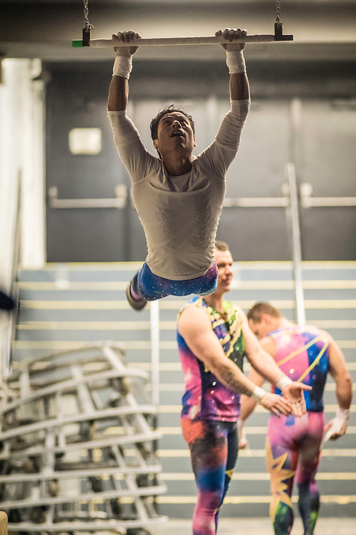 BALTIMORE, MD -- 4/21/17 -- Mauricio Eusebio Navas Sanchez, warms up on the trapeze backstage. Ringling Bros, the self-proclaimed Greatest Show on Earth, is in the final leg of a 146 year run. The final performances will be held in May. Out of This World, one of two circus units, recently had performances in Baltimore, led by Jonathan Lee Iverson, the first African-American ringmaster in the show's history…by André Chung #_AC27746