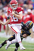 LITTLE ROCK, AR - NOVEMBER 29:  Jack Lindsay #18 of the Arkansas Razorbacks is hit from behind by Ronnell Perkins #3 of the Missouri Tigers at War Memorial Stadium on November 29, 2019 in Little Rock, Arkansas  The Tigers defeated the Razorbacks 24-14.  (Photo by Wesley Hitt/Getty Images) *** Local Caption *** Jack Lindsay; Ronnell Perkins