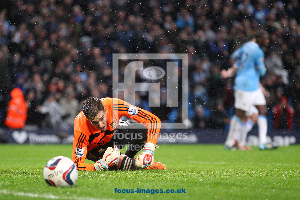 Picture by Paul Chesterton/Focus Images Ltd +44 7904 640267<br /> 08/01/2014<br /> Adrian of West Ham looks dejected as the Man City players celebrate their side's 3rd goal during the Capital One Cup Semi Final 1st Leg match at the Etihad Stadium, Manchester.