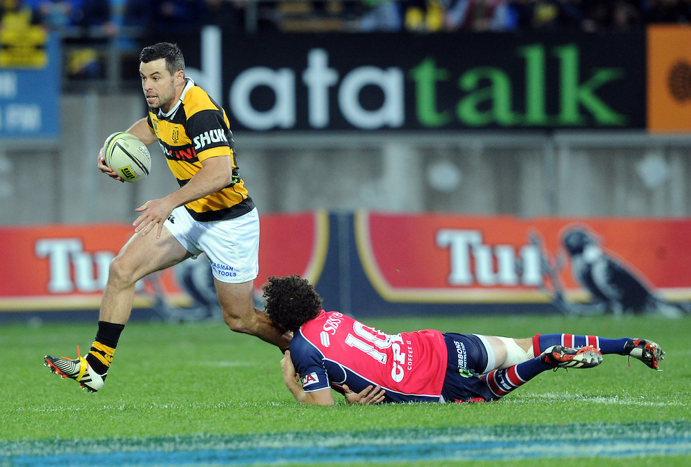 Taranaki's James Marshall slips the tackle of Tasman Makos Marty Banks in the ITM Cup Rugby Premiership final match at Yarrow Stadium, New Plymouth, New Zealand, Saturday, October 25, 2014. Credit:SNPA / Ross Setford