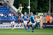 Kwesi Appiah of AFC Wimbledon heads the ball during the EFL Sky Bet League 1 match between Peterborough United and AFC Wimbledon at London Road, Peterborough, England on 28 September 2019.