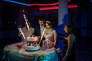 Groom Davit Simonyan, 24, and bride Shogher Hovsepyan, 25, prepare to cut the cake at their wedding reception on April 18, 2015 in Stepanakert, Nagorno-Karabakh. Since signing a ceasefire in a war with Azerbaijan in 1994, Nagorno-Karabakh, officially part of Azerbaijan, has functioned as a self-declared independent republic and de facto part of Armenia, with hostilities along the line of contact between Nagorno-Karabakh and Azerbaijan occasionally flaring up and causing casualties.