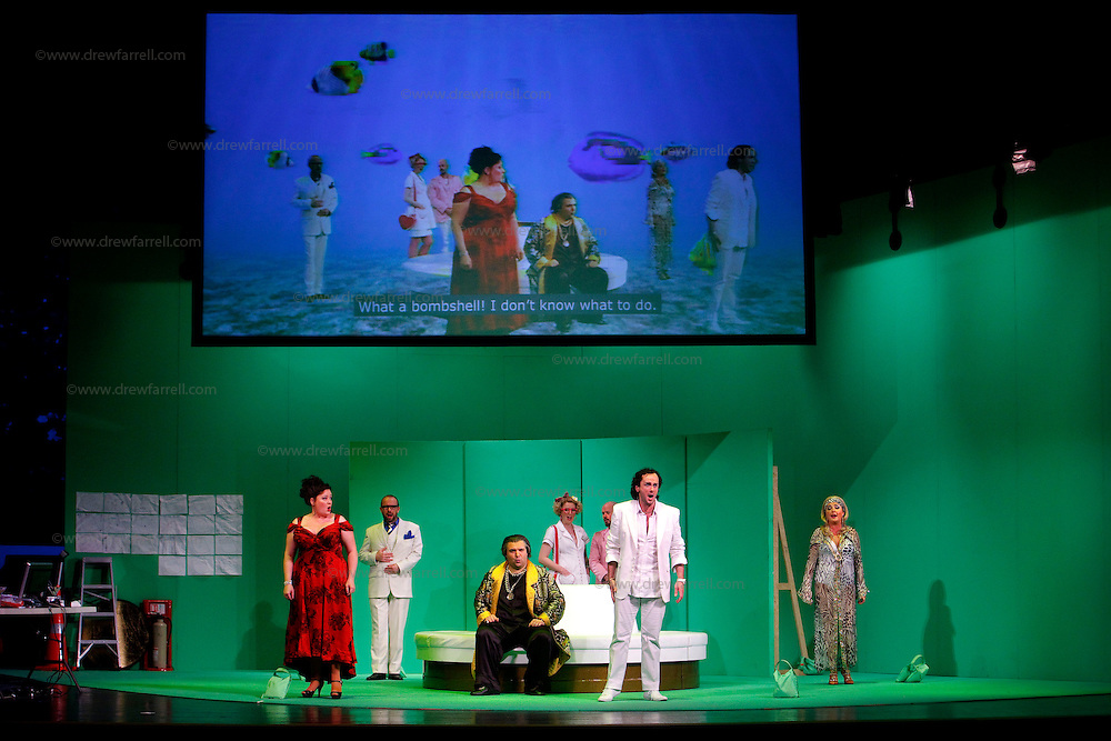 Picture shows : Tiziano Bracci as Mustafa (seated), Thomas Walker as Lindoro (white shirt-front) and Karen Cargill as Isabella (l)..Picture  ©  Drew Farrell Tel : 07721 -735041..A new Scottish Opera production of  Rossini's 'The Italian Girl in Algiers' opens at The Theatre Royal Glasgow on Wednesday 21st October 2009..(Soap) opera as you've never seen it before.Tonight on Algiers.....Colin McColl's cheeky take on Rossini's comic opera is a riot of bunny girls, beach balls, and small screen heroes with big screen egos. Set in a TV studio during the filming of popular Latino soap, Algiers, the show pits Rossini's typically playful and lyrical music against the shoreline shenanigans of cast and crew. You'd think the scandal would be confined to the outrageous storylines, but there's as much action off set as there is on.....Italian bass Tiziano Bracci makes his UK debut in the role of Mustafa. Scottish mezzo-soprano Karen Cargill, who the Guardian called a 'bright star' for her performance as Rosina in Scottish Opera's 2007 production of The Barber of Seville, sings Isabella..Cast .Mustafa...Tiziano Bracci.Isabella..Karen Cargill.Lindoro...Thomas Walker.Elvira...Mary O'Sullivan.Zulma...Julia Riley.Haly...Paul Carey Jones.Taddeo...Adrian Powter..Conductors.Wyn Davies.Derek Clarke (Nov 14)..Director by Colin McColl.Set and Lighting Designer by Tony Rabbit.Costume Designer by Nic Smillie..New co-production with New Zealand Opera.Production supported by.The Scottish Opera Syndicate.Sung in Italian with English supertitles..Performances.Theatre Royal, Glasgow - October 21, 25,29,31..Eden Court, Inverness - November 7. .His Majesty's Theatre, Aberdeen  - November 14..Festival Theatre,Edinburgh - November 21, 25, 27 ...Note to Editors:  This image is free to be used editorially in the promotion of Scottish Opera. Without prejudice ALL other licences without prior consent will be deemed a breach of copyright under the 1988. Copyright Design and Patents Act  and will be su